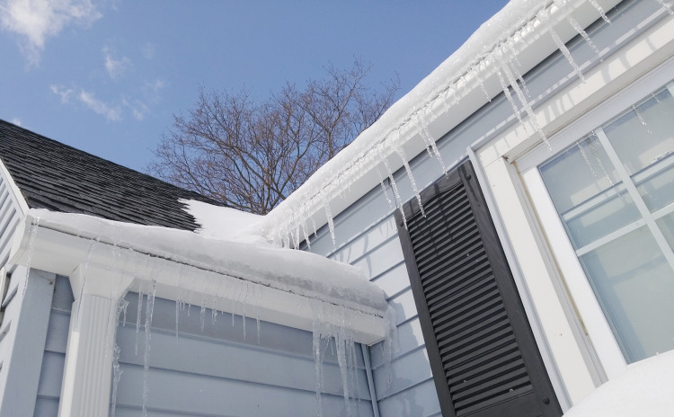 Why Do Icicles & Ice Dams Form on My Roof & What to Do About Them?